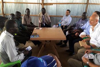 Ambassador and deputy permanent representative of the UK mission to the UN, Peter Wilson (far Right), speaking to an IDP in Juba 5 Sept 16.
