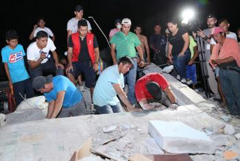 People search through rubble caused by the earthquake in Pedernales canton in Manabí province of Ecuador.