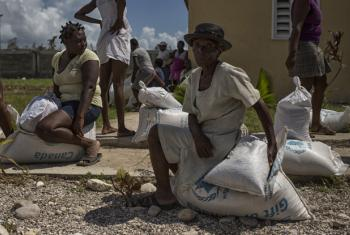 The World Food Programme (WFP) and their local partner Fondation pour le Développement et L'encadrement de la Famille Haïtienne (Fondefh), distribute food to residents of Torbek, a commune on the outskirts of Les Cayes that was heavily damaged by Hurrican