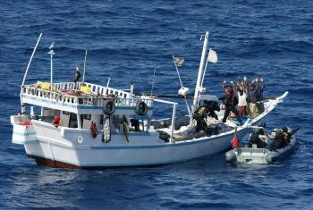 Boarding a pirate vessel off the coast of Somalia.
