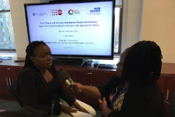 Rita Lopidia Abraham (left) is interviewed by Jocelyne Sambira of UN Radio.