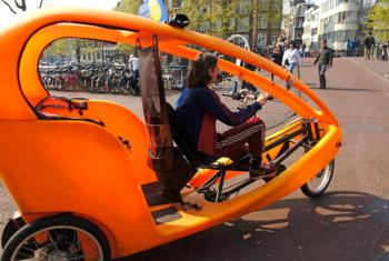 Bicycle-taxi in the streets of Amsterdam, Netherlands.