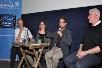 A picture of the panel discussion displaying Martin Nesirky, Johanna Kuchling, Seth Kramer and Professor Peter Schweitzer (from left to right).