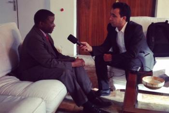 Chaloka Beyani (left) is interviewed by Mohammad Hamed Haleemi of UN Radio.