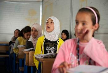 Girls attend class in Za'atari, the world's second-largest refugee camp.