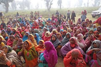 Flood-affected women of Nepal, wait to receive dignity kits.