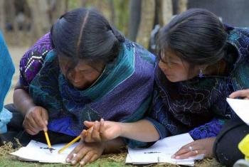 Women of the Tzotzil people learn to write at a UN-backed literacy programme for artisans in Chiapas, Mexico.