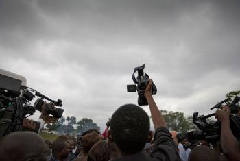 A crowd of journalists in Maluku transit camp, on the outskirts of Kinshasa, the capital of the Democratic Republic of the Congo.