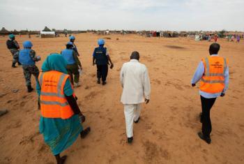 UNAMID police officers and community policing volunteers patrol IDP camp.