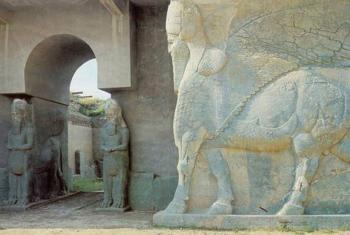 A statue of a lamassu, an Assyrian protective deity, at the North West Palace of Ashurnasirpal in Nimrud, Iraq.
