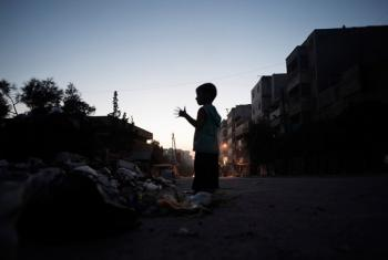 A child standing amid debris on a street in Aleppo. (file)