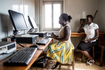 A woman in South Sudan is learning to access and browse the Internet.