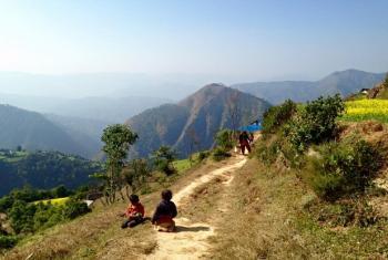 Village children play along a mountain trail in Arghakhanchi district, Nepal.