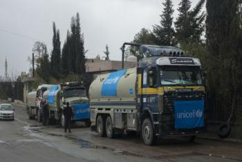 UNICEF-supported trucks queue to fill their tanks with water from a group of wells rehabilitated and equipped by the UN agency, Damascus, Syria. UNICEF/UN048100/Al-Asadi