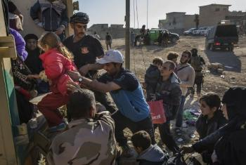 Families flee their homes in Mosul, Iraq, heading for an army outpost in the Samah neighbourhood where they will be taken away from the heavy fighting engulfing the city.