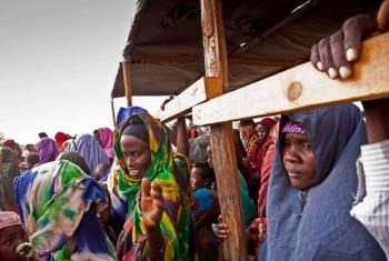 Somali refugees queue at a reception centre in Kenya.
