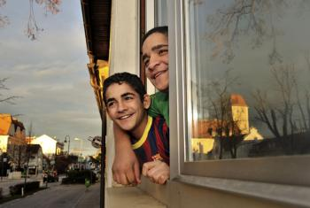 Syrian refugee children looking out from their new home in the small town of Gänserndorf, Austria. They are on a resettlement program for Syrian refugees, in cooperation with UNHCR.
