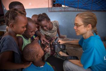 Cornelia Walther (right) speaks to a group of children in Haiti. Photo courtesy of Cornelia Walther