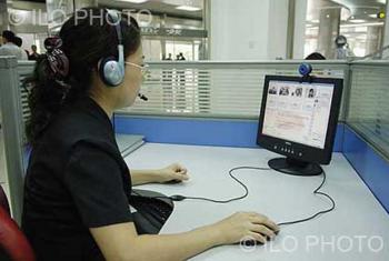 Human resources development and employment centre. This woman is using the centre's database to find employment. Tianjin. China.