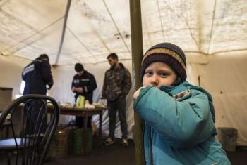 A young displaced Ukrainian boy finds shelter from the cold in a tent in Slovyansk. His family hope to move to Kyiv after leaving the conflict-torn town of Debaltseve.