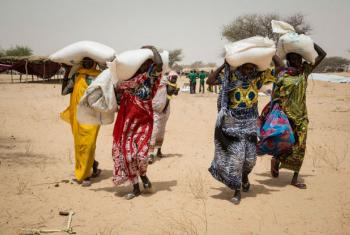 People living in the Melia IDP camp, Lake Chad, receiving WFP food. Most of the displaced come from the Lake Chad islands, that have been abandoned because of insecurity.