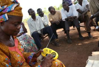 Residents at the at the Sangari site for internally displaced people in Central African Republic (CAR) listening to Radio Lego Ti la Ouaka (The Voice of Ouaka). The community radio in Bambari is bringing together Muslims and Christians to build tolerance