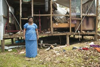 Salote Tubuna, a Fiji Rakiraki market vendor and farmer, outside one of her two small houses in Buka Settlement just outside of Rakiraki.