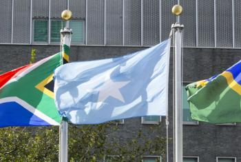 The flag of the Federal Republic of Somalia (centre) flying at United Nations headquarters in New York.