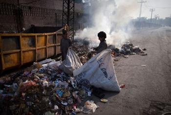 Children collect garbage in Lahore, State of Punjab, Pakistan.