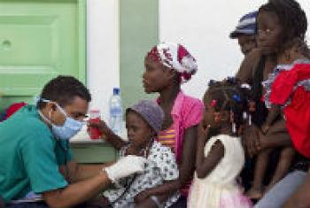 Patients with cholera are treated by a doctor at the hospital in L'Estere, Haiti.