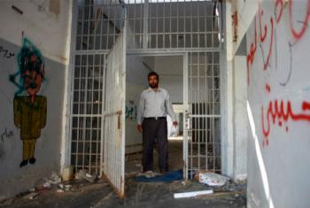 A former inmate of the Abu Salim prison in Tripoli, Libya, returned to visit his cell in October 2011.
