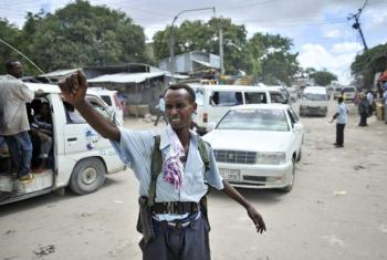 A policeman directs traffic at a checkpoint in downtown Mogadishu, Somalia.