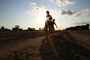 Two children carry water in Leer, Unity State in South Sudan, parts of which have been declared as famine-affected.