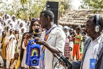 To mark World Radio Day, UNAMID Communications and Public Information Section (CPIS) distributed solar powered wind-up radios to the students of Al Salam 26 Basic School for Girls at Al Salam IDP camp, in El Fasher, North Darfur. In the picture, a CPIS's