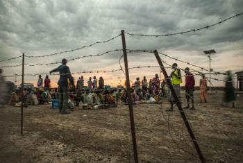Internally displaced persons (IDPs) line up early in the morning for a general food distribution at the UN Protection of Civilians Site, Malakal, South Sudan.