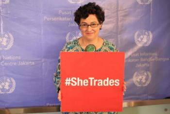 Executive Director of ITC, Ms. Arancha González holding #SheTrades placard. File