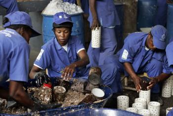 "The United Nations Development Programme (UNDP)'s ""Cash for Work"" initiative partners with the Sant Triyaj Fatra Kafoufey recycling factory in Port-au-Prince to turn paper trash collected from the streets into briquettes. The paper briquettes can be used"