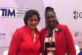 International Trade Centre Executive Director Arancha González (left) congratulates Hellen Odegi of Skylon Global Company. (