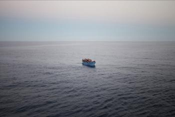 An overloaded boat of refugees and migrants trying to reach Europe as seen from the deck of the Italian Coastguard ship, the San Giorgio, during a Mediterranean patrol in 2014.