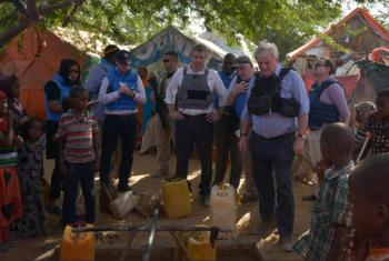 Stephen O'Brien (right), visits a water point in the Dayniile IDP camp on the outskirts of Mogadishu, Somalia, on March 6, 2017.
