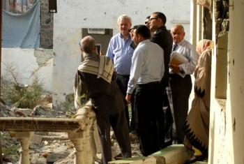 In Yemen, Stephen O'Brien, Under-Secretary-General for Humanitarian Affairs talks with local residents outside damaged building in Aden.