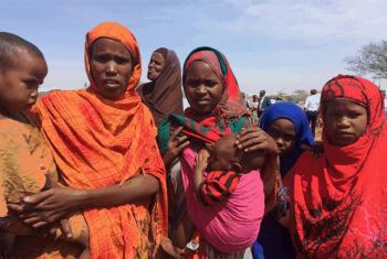 Women displaced by drought waiting to meet Secretary-General António Guterres during his visit to Baidoa, Somalia, where the focus was on famine and cholera.