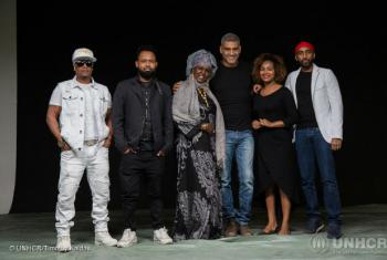The recording artists who performed 'Dangerous Crossings', a UNHCR-produced song raising awareness of the dangers of migrating to Yemen, are photographed in the studio.