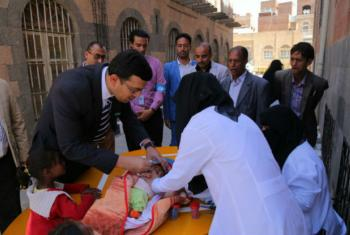 Dr Sherin Varkey (left) at launch of a national immunization campaign at a health facility in Sana'a, Yemen.