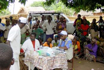 A mobile team of national health care workers performing systematic screening of population for human sleeping sickness in Bodo village, Chad. (file)