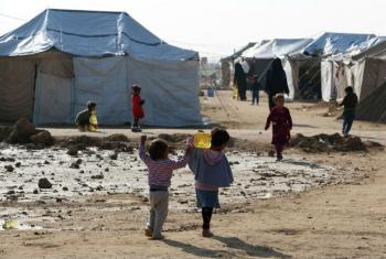 Children carrying jars of cooking oil at an IDP camp on the outskirts of Fallujah, Iraq. (file)