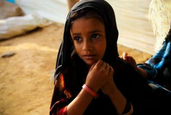In Mazrak, Yemen, a five year-old girl, diagnosed as malnourished, is given a pink wristband to wear to show she has not been getting enough to eat.