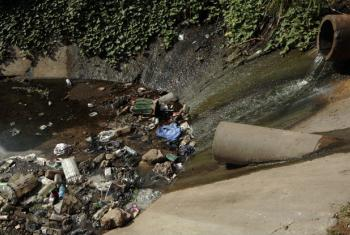 Water, along with pollutants and contaminating agents, flows into a canal in Maputo, Mozambique. (File)