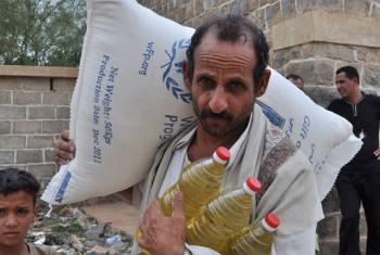 A farmer collects food ration for his family. An estimated 12 million Yemenis are food insecure. (file)