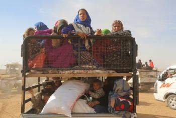 Displaced children and adults in Syria are seen in a vehicle after fleeing from ISIL-controlled areas in rural Raqqa to Ain Issa, the main staging point for displaced families, some 50 kilometres north of Raqqa city. (file)